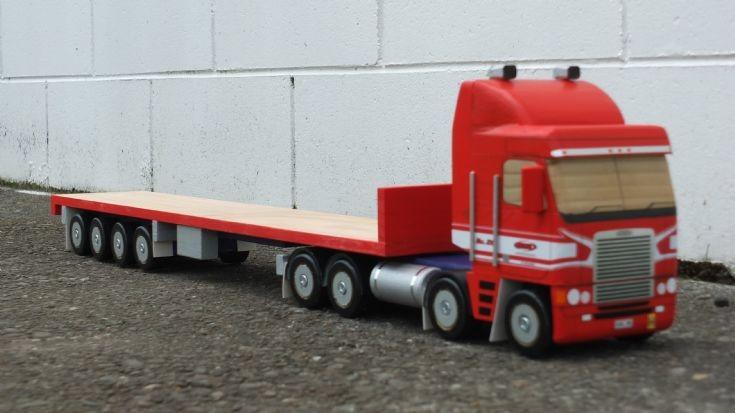 Freightliner 8x4 towing quad axle flatdeck semi